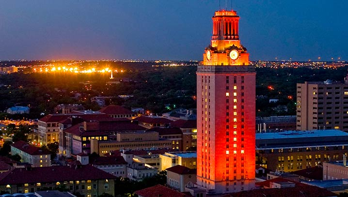 The University of Texas tower with windows lit up displaying the number 1